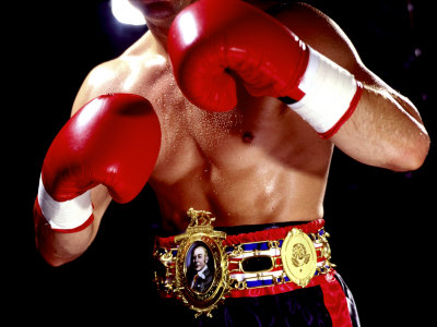 torso-of-a-male-boxer-wearing-boxing-gloves-and-a-belt.jpg