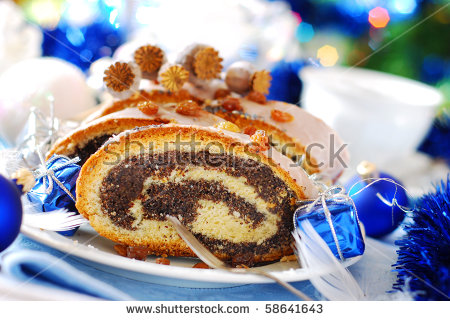 stock-photo-traditional-poppy-cake-with-icing-and-raisins-for-christmas-58641643.jpg