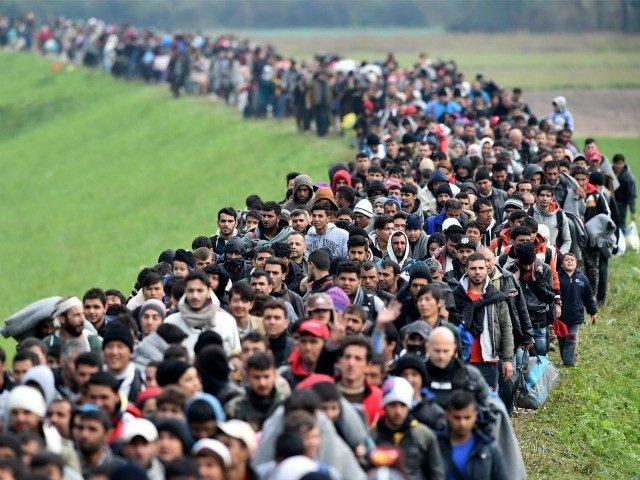 """Dalsze wzbogacanie kulturowe-przyjmowanie uchodźców,malowanie kredą po asfalcie,więcej rozdawania kwiatów,minuty ciszy,plakaty """"love is my religion"""""""