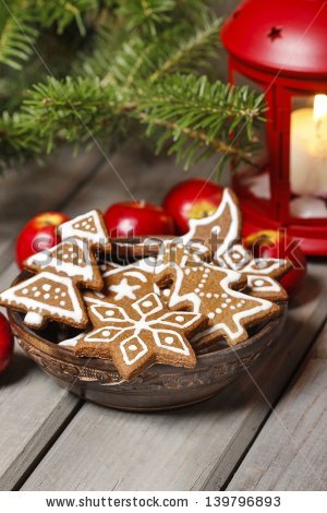 stock-photo-bowl-of-gingerbread-cookies-on-rustic-grey-wooden-table-under-green-fir-branch-copy-space-139796893.jpg