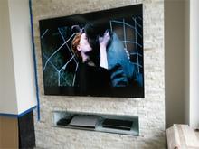 Instalacja telewizora na ścianie 50 - 60 cali